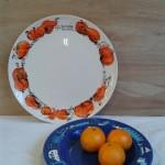 Beschilderd porselein- herfstbord en bord met huisjesrand Adrienne van Wartum